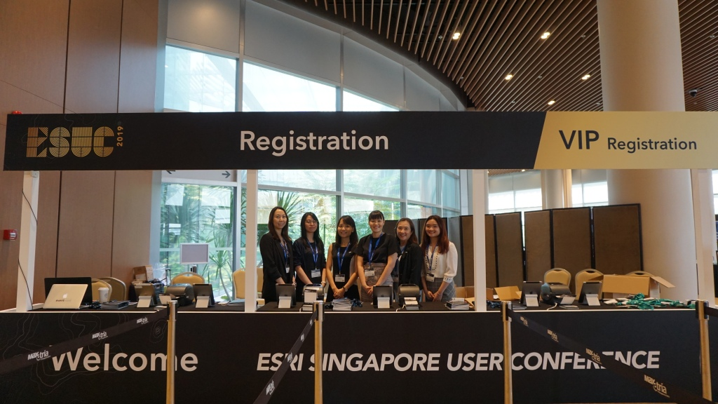 ESRI employees managing the registration booths